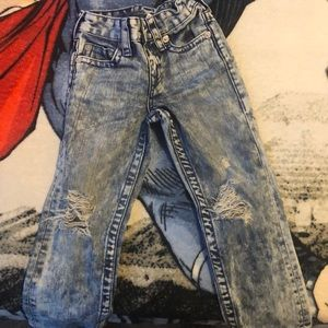 True religion stone wash cut up jeans